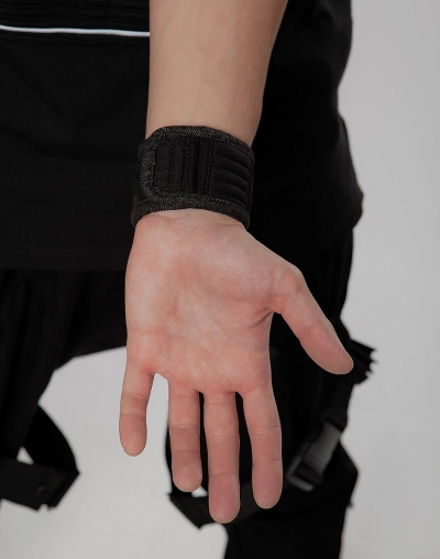 The wristband/bracelet under the watch